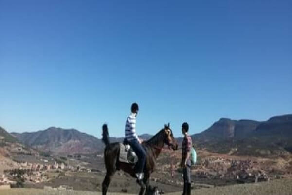 two tourists and one horse in atlas mountains