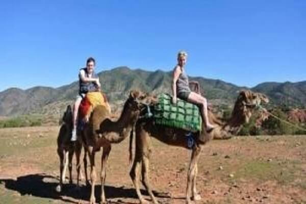 two ladys riding a camel