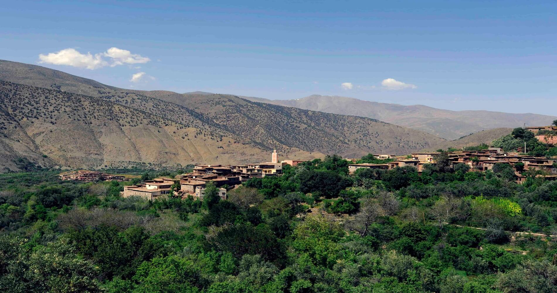 green valley with old buildings in atlas mountains