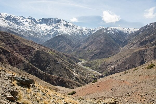green valley and snowy mountains in morocco