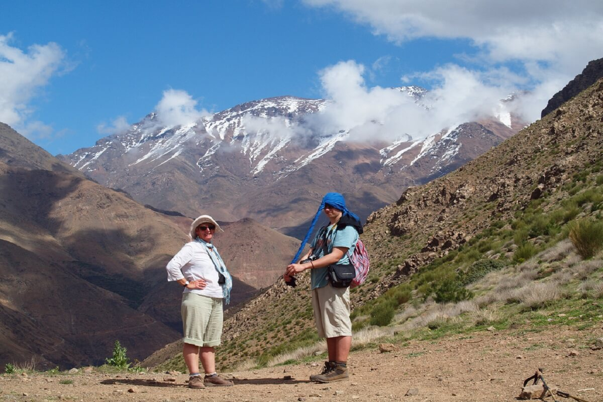 two people standing on mountain passe