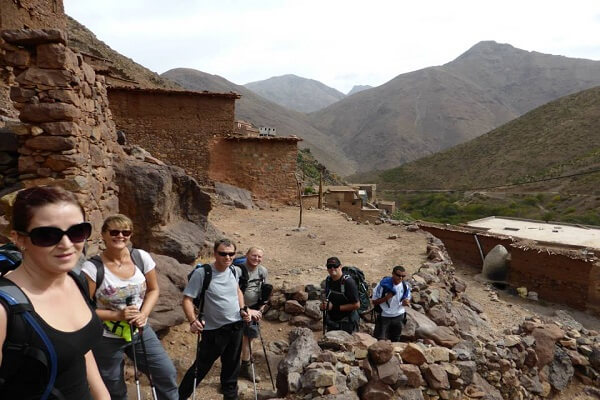 group of tourist walking in old village