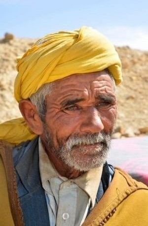 a berber man with scarf