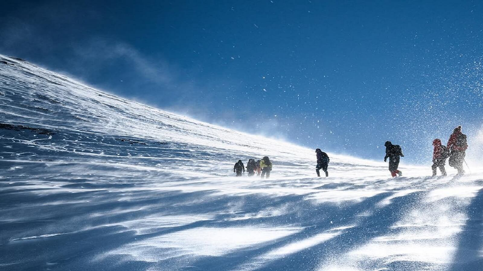 people climbing mountain with snow